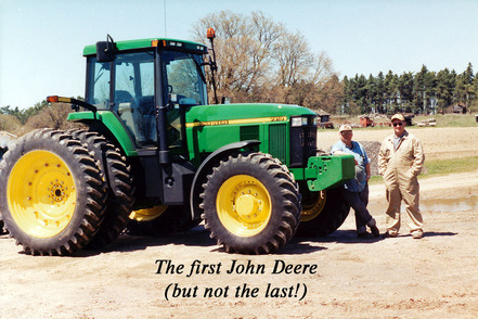 John Thompson and RJ Thompson with their first John Deere tractor